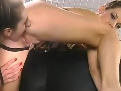 Hot chick licking wet pussy in cage